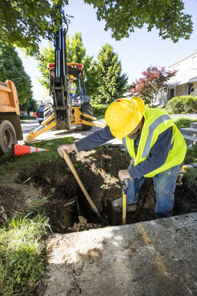 Laborer digging at jobsite.