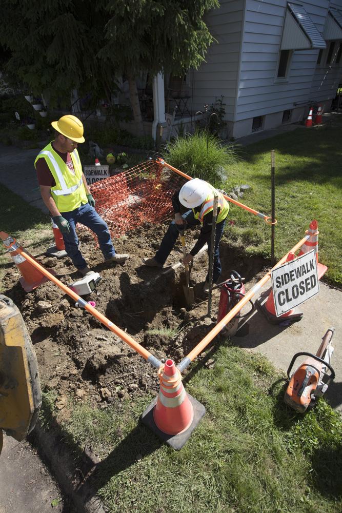 Laborer digging on job site