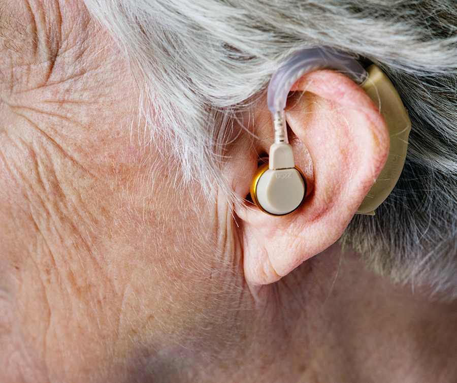 Senior with hearing aid